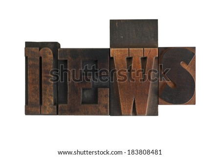 word news in vintage wooden letterpress type, scratched and stained, isolated on white background - stock photo