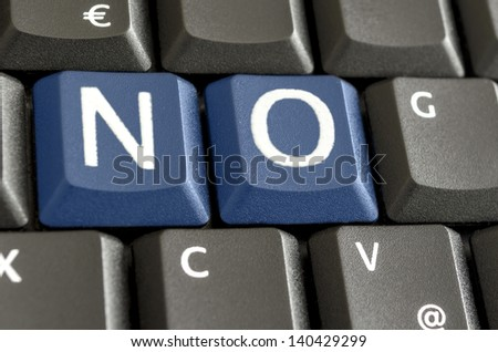 Word NO written with blue keys on computer keyboard. - stock photo