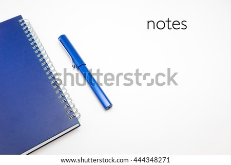 Word Notes with Notebook and pen isolated on white background