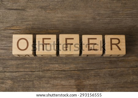 word offer on wooden cubes - stock photo