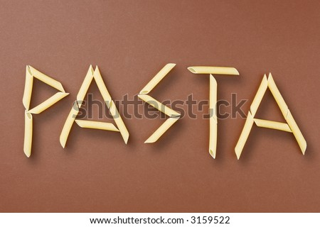 Word pasta written with penne rigate pasta - stock photo