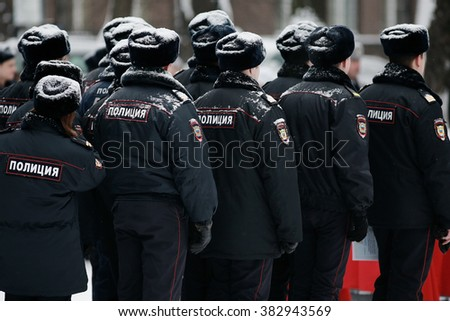 "word ""police"" on the back, police in formation Russian winter"