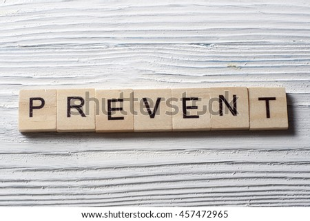 word PREVENT on wooden abc cubes at wood background. - stock photo
