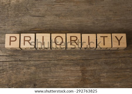 word priority on wooden cubes - stock photo