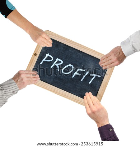 Word profit on chalkboard held by hands - stock photo