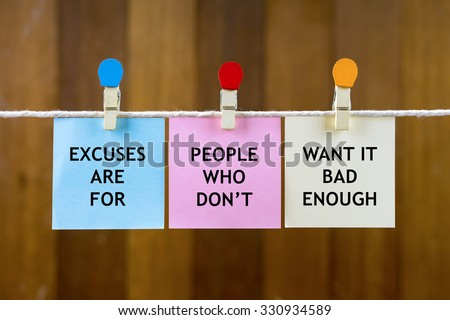 Word quotes of EXCUSES ARE FOR PEOPLE WHO DON'T WANT IT BAD ENOUGH on colorful sticky papers hanging by a rope against blurred wooden background. - stock photo