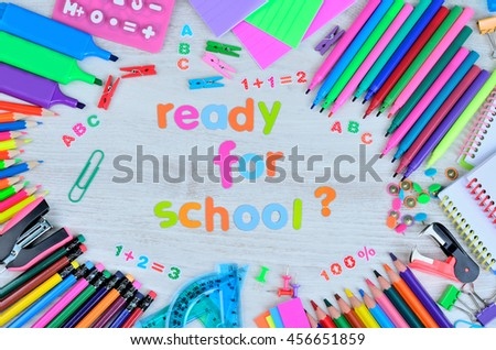 word ready for school and stuff for school on gray wooden table