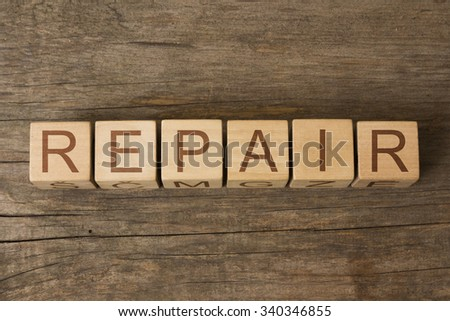 word REPAIR on wooden cubes - stock photo