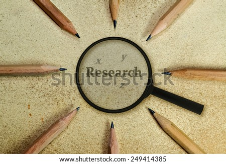 Word Research under a magnifying glass on vintage background - stock photo