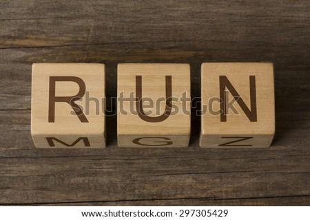 word run on wooden cubes - stock photo