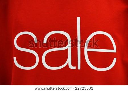 "word ""sale"" on textile texture - stock photo"