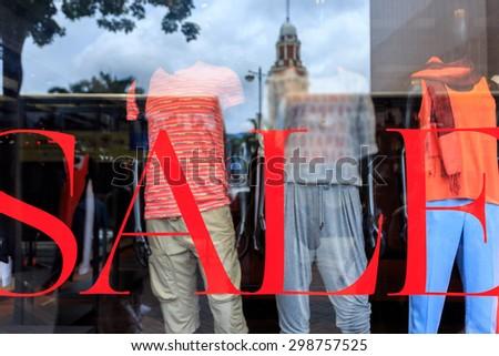 word sale print on shopfront window - stock photo