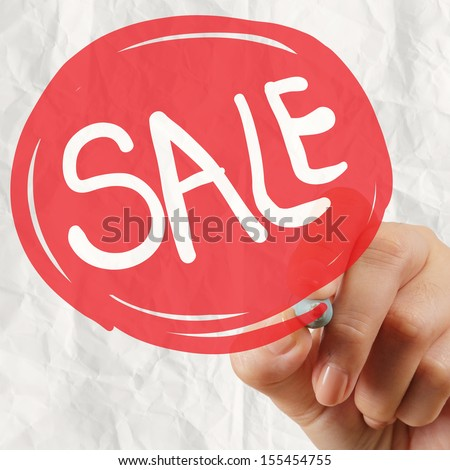 word sale with crumpled paper background as concept design - stock photo