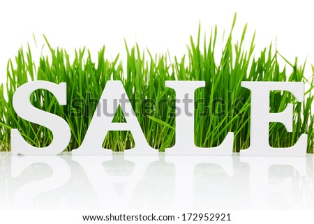 """Word """"Sale"""" with fresh grass isolated on white - stock photo"""