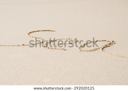 "word ""sea"" written on sand on a beach - stock photo"