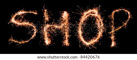 Word SHOP made of sparklers - stock photo