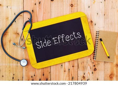 Word Side Effects written on blackboard and stethoscope  - stock photo