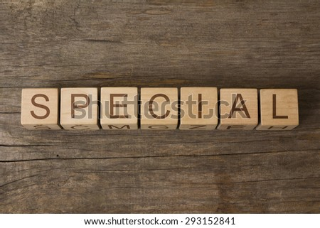 word special on wooden cubes - stock photo