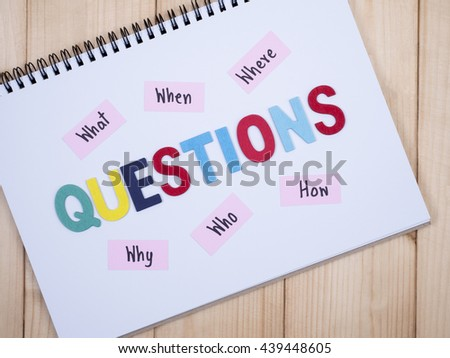 Word spell questions and handwriting what, when, where, why, who, how on white notebook - stock photo