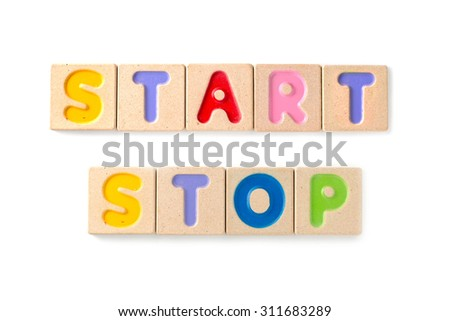 """word """"start"""" and """"stop"""" written with letterpress printing blocks on white background - stock photo"""