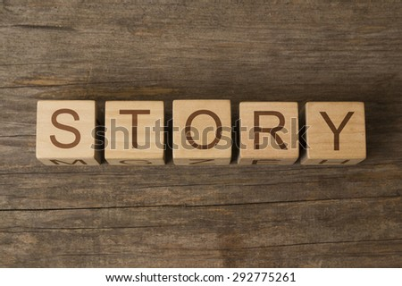word story on wooden cubes - stock photo