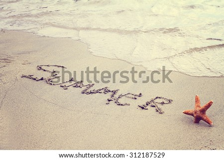 Word summer written in sand on the beach and starfish. Summer holiday, vacation wallpaper, postcard background concept. Vintage image