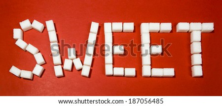 Word sweet on red background.  - stock photo