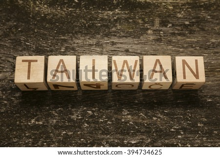 Word TAIWAN on a wooden background - stock photo