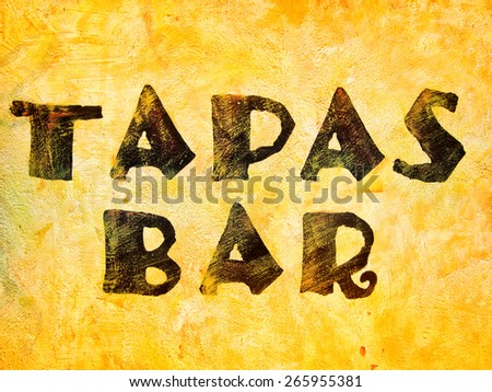 word tapas bar parinted on a house wall - stock photo