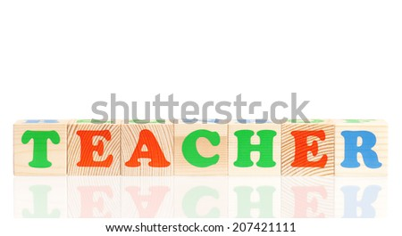 Word TEACHER composed from wood cubes isolated on white background
