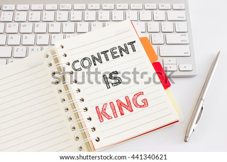 Word text Content is king on white paper on office table / business concept