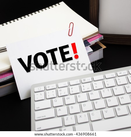 Word text Vote on white paper card / business concept