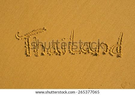 Word Thailand written on a wet sandy beach - stock photo
