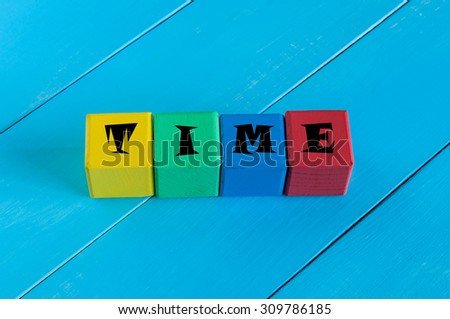 Word Time on children's colourful cubes or blocks. - stock photo