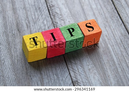 word tips on colorful wooden cubes - stock photo
