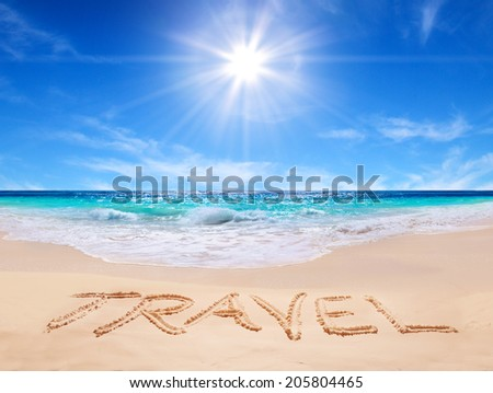"word ""travel"" on the tropical beach"