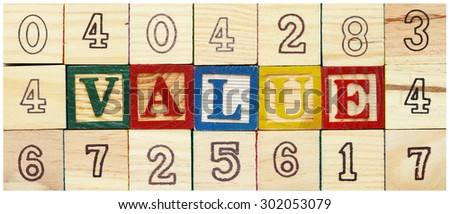 "Word ""VALUE"" among alphabet wooden blocks - stock photo"