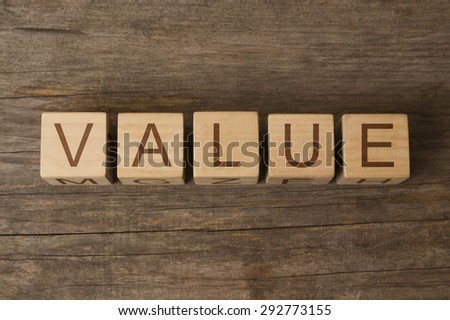 word value on a wooden cubes - stock photo
