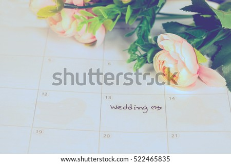 word wedding on calendar with sweet flowers   ,love concept