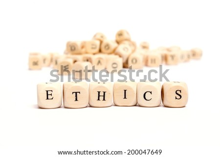 word with dice on white background - ethics - stock photo