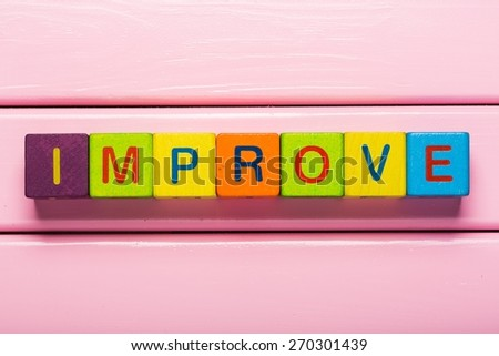 Word. Word Improve on a wooden blocks. Motivational concept - stock photo