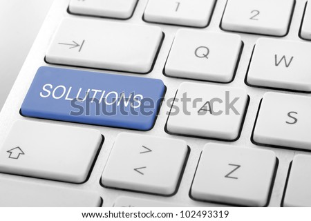 Wording Solutions on computer keyboard - stock photo