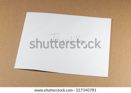 wording thank you of white envelope on brown background - stock photo
