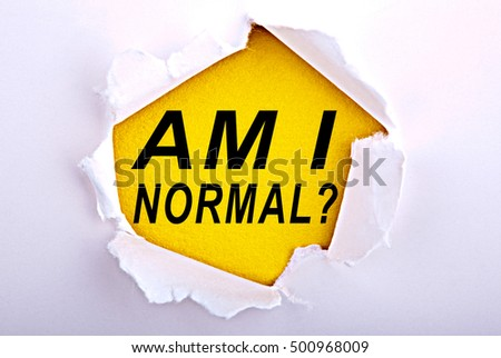 Words Am i Normal on ripped paper - Business, technology, internet concept. Stock Photo