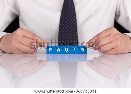 "Words ""FAQ'S"" with blocks - stock photo"
