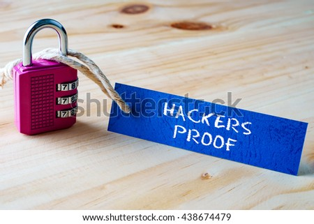 Words HACKERS PROOF written on tag label tied with a padlock. - stock photo