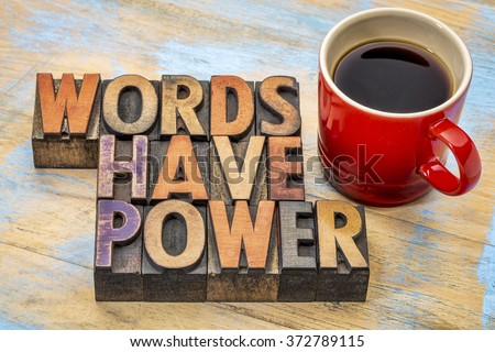 words have power  phrase in vintage letterpress wood type printing blocks stained by color inks with a cup of coffee - stock photo
