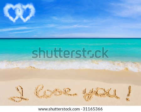Words I Love You on beach and connected hearts clouds - stock photo