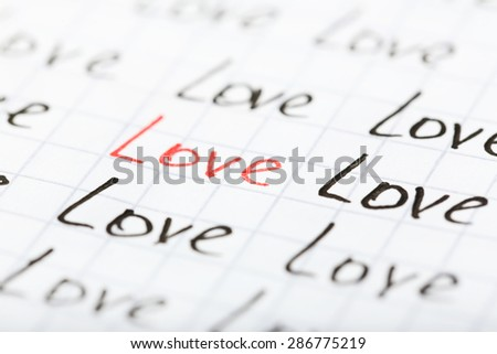 Words LOVE written on sheet of paper background