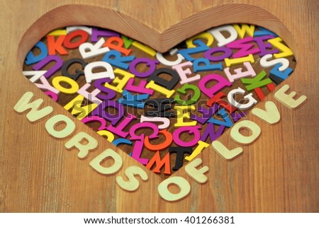 Words Of Love Sign And Many Different Color English Letters Or Alphabet In Heart Shape Made Of Wood, Copy Space, Background, Close Up